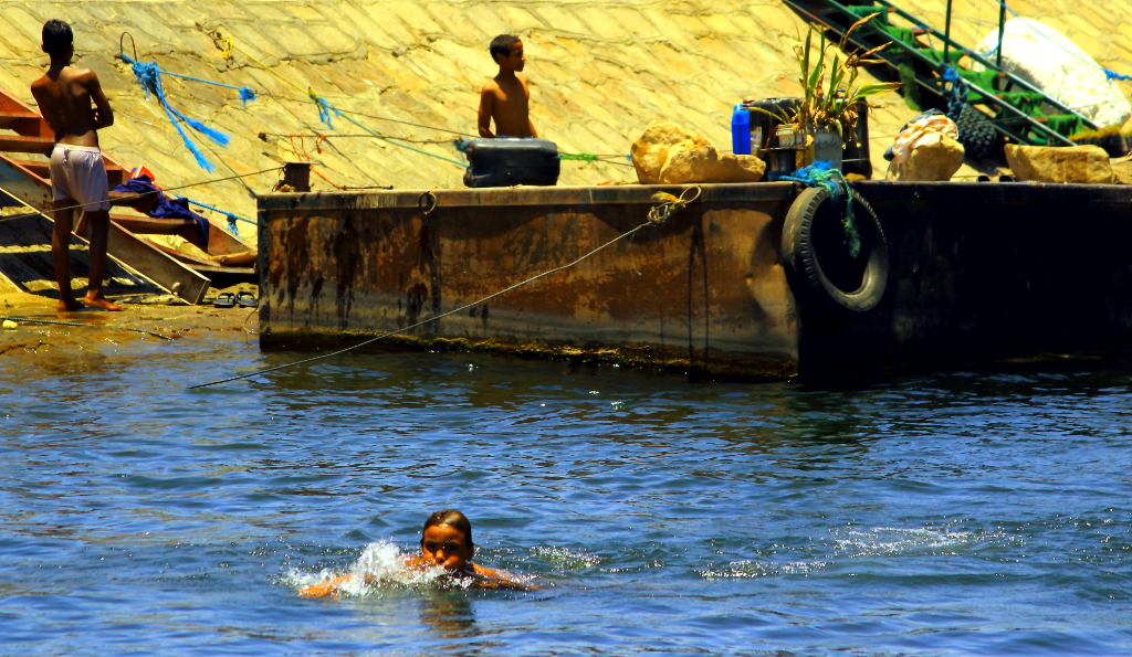 Children swimming in the Nile near Luxor, Egypt on Mallory on Travel adventure photography