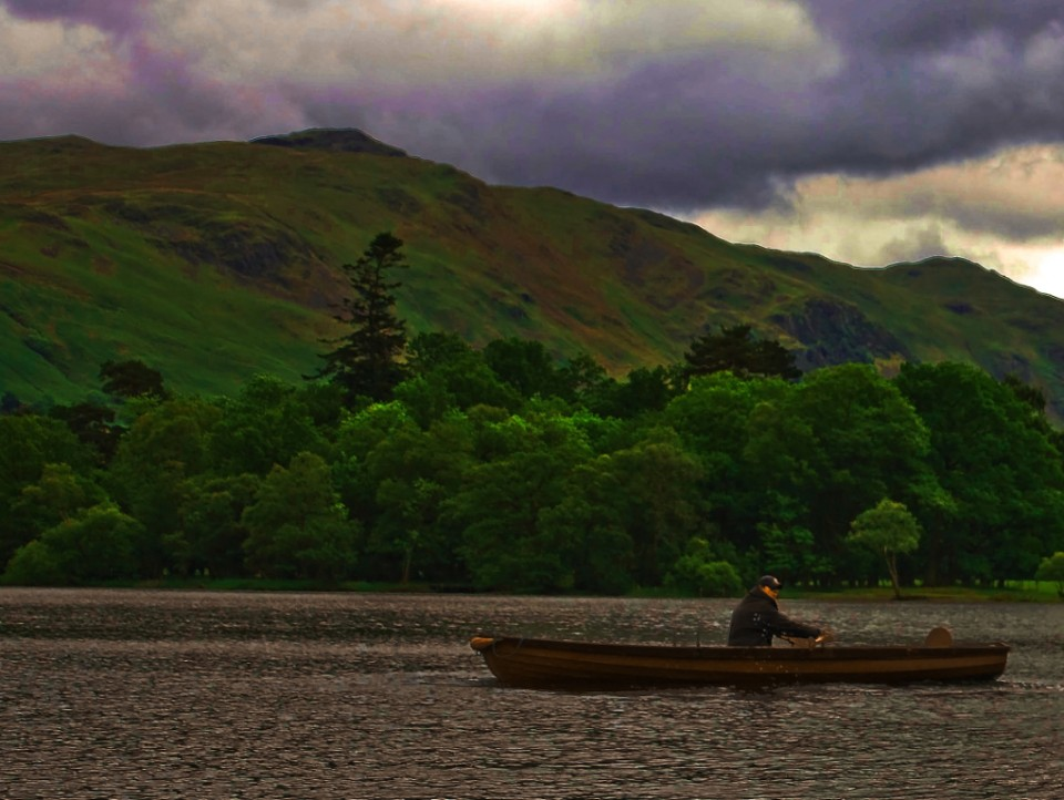 Journeying; Rowing boat on Ullswater in the English Lake District on Mallory on Travel, adventure, photography