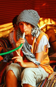 Enjoying a shisha in a Bedouin camp in the Egyptian desert near Sharm el Sheik on Mallory on Travel, adventure, photography