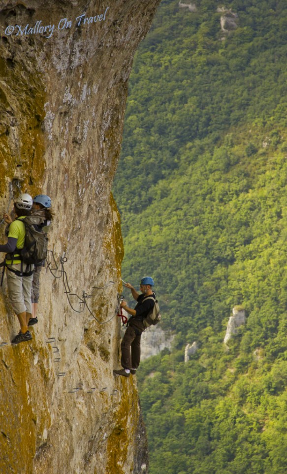 Adventurer high on a rockface in the Aveyron, France on Mallory on Travel, adventure, photography
