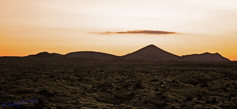 Sunset over the volcanic Icelandic moonscape outside the Lagoon on Mallory on Travel, adventure, adventure travel, photography