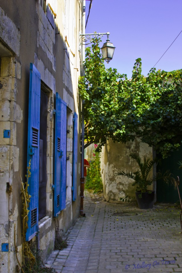 Exploring the backstreets of St Martin, capital of I'lè de Ré in Poitou-Charentes in France on Mallory on Travel, adventure, adventure travel, photography