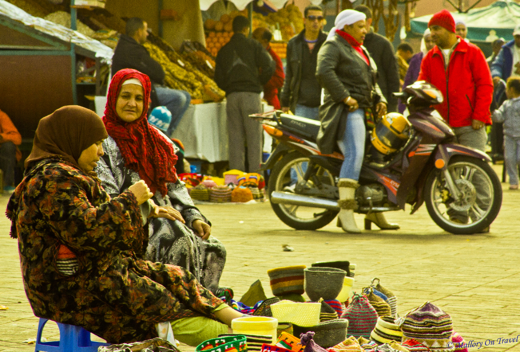 Wanderlusting; Berber women enjoying conversation at Djemaa el Fna in Marrakech, Morocco on Mallory on Travel, adventure, adventure travel, photography
