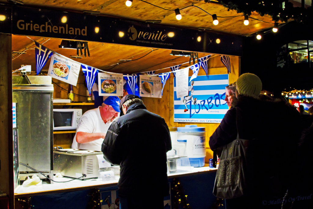 The Greek food stall at the Christmas market in Lucerne, Switzerland  on Mallory on Travel, adventure, adventure travel, photography