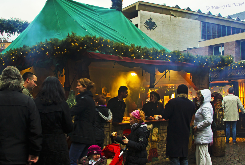 Foodstall at the Christmas market in Cologne, Germany  on Mallory on Travel, adventure, adventure travel, photography