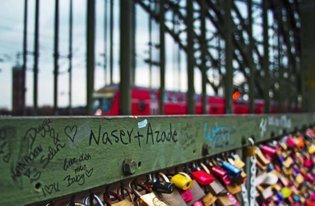 Trains and love locks over the River Rhine in Cologne, Germany  on Mallory on Travel, adventure, adventure travel, photography