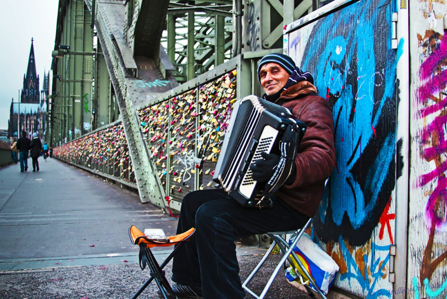 Busker on the Cologne railway Bridge of locks over the Rhine, Germany on Mallory on Travel, adventure, adventure travel, photography iain_mallory_06720