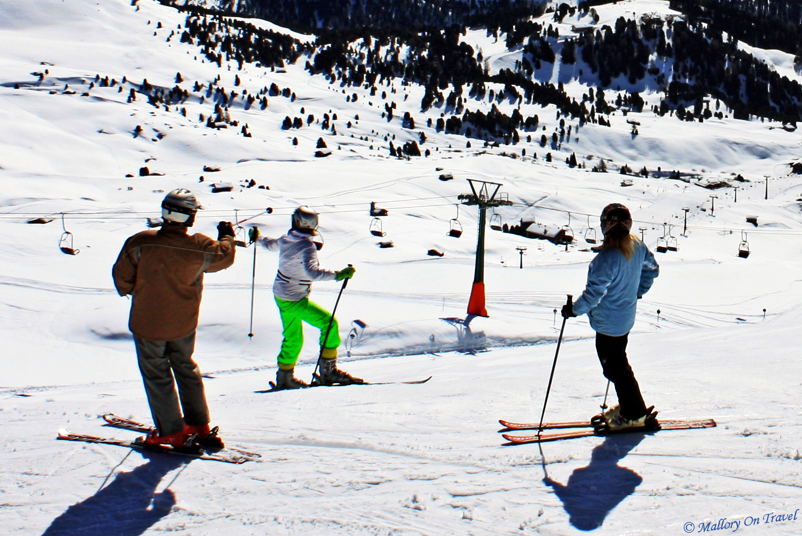 Tourist skiers on the piste in the Italian Sud Tirol  on Mallory on Travel, adventure, adventure travel, photography