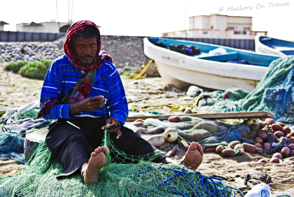 Seeb fisherman near Muscat the capital city of the Sultanate of Oman  on Mallory on Travel, adventure, adventure travel, photography