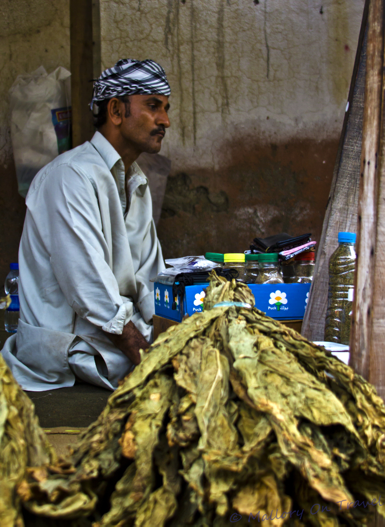 Selling tobacco at the Seeb souk near Muscat in the Sultanate of Oman  on Mallory on Travel, adventure, adventure travel, photography