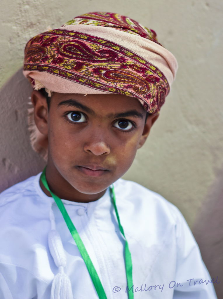 Travel Inspiration; A young boy at the Muscat Festival in the Sultanate of Oman on Mallory on Travel, adventure, adventure travel, photography
