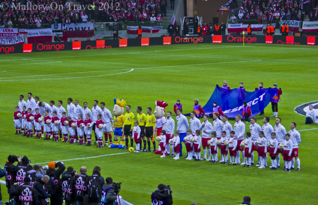Poland and Portugal line up at the Polish National Football Stadium in Warsaw on Mallory on Travel, adventure, adventure travel, photography
