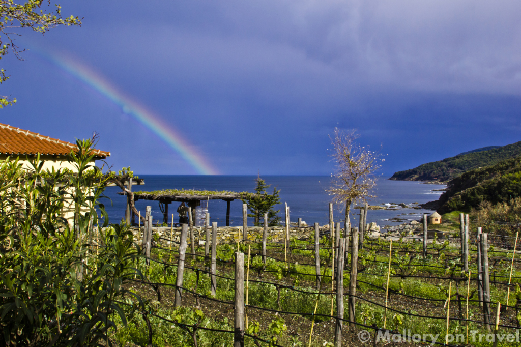 Rainbow over the small vingeyards of the Mylopotamos monastery on the Holy Mountain, Mount Athos, Greece on Mallory on Travel adventure photography