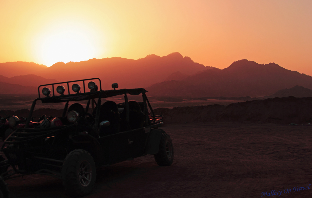 Offroad vehicle at sunset in the desert of Egypt, near Sharm el Sheik on the Red Sea on Mallory on Travel adventure, photography