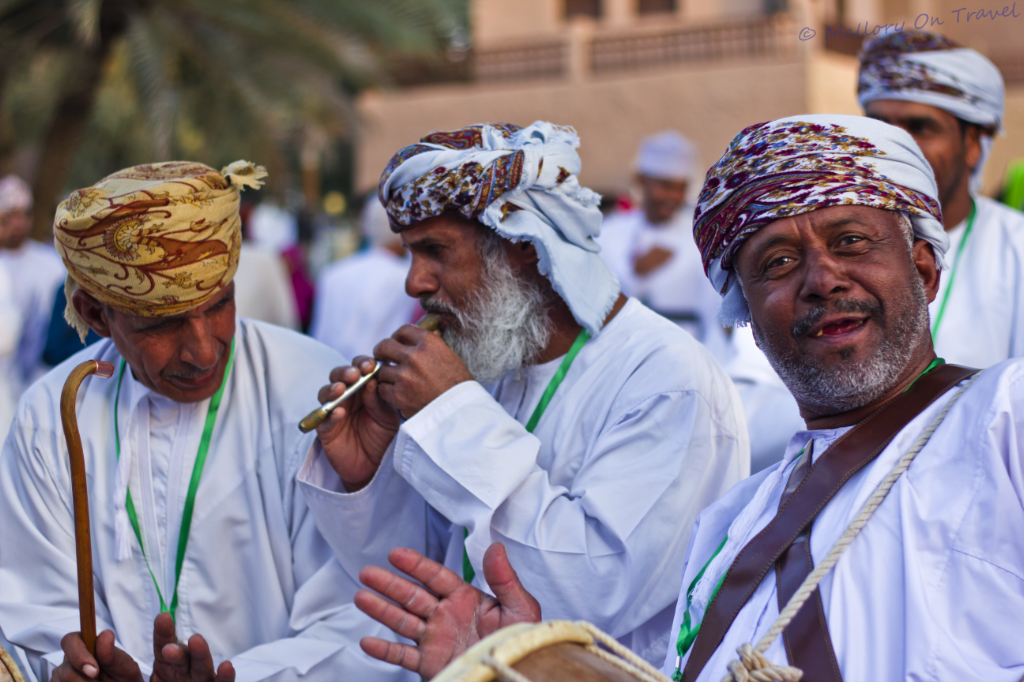Traditional nomadic muscians performing at the Muscat Festival in Oman on Mallory on Travel adventure photography