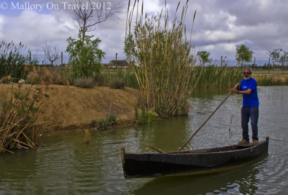 Traditional poling method of boating near Alfacs Bay in the Delta L'Ebre in Catalonia, Spain on Mallory on Travel adventure photography