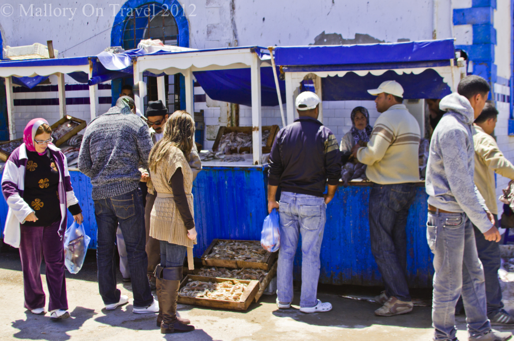 The fishmarket stalls of Essaouira selling Morcoccan Atlantic fish  on Mallory on Travel, adventure, adventure travel, photography