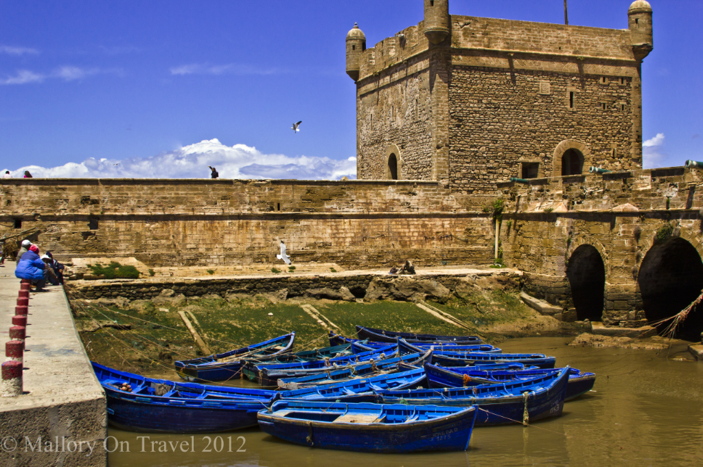 Fishing boats under the ramparts of the Moroccan port of Essaouira on the Atlantic coast  on Mallory on Travel, adventure, adventure travel, photography