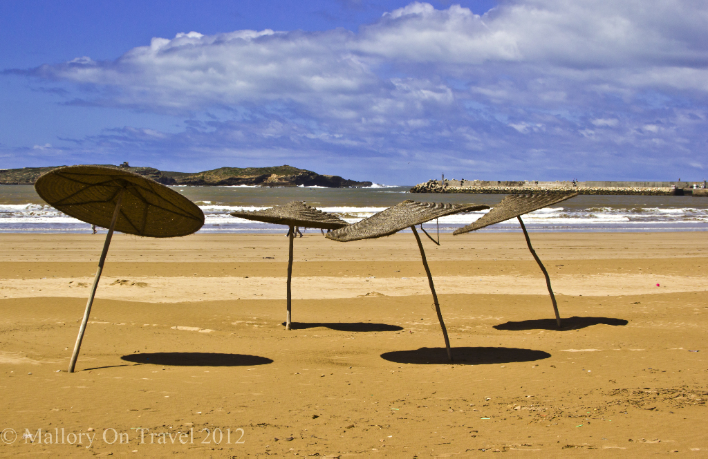 Sunshades on the Atlantic beach of Essaouira, Morocco on Mallory on Travel adventure photography