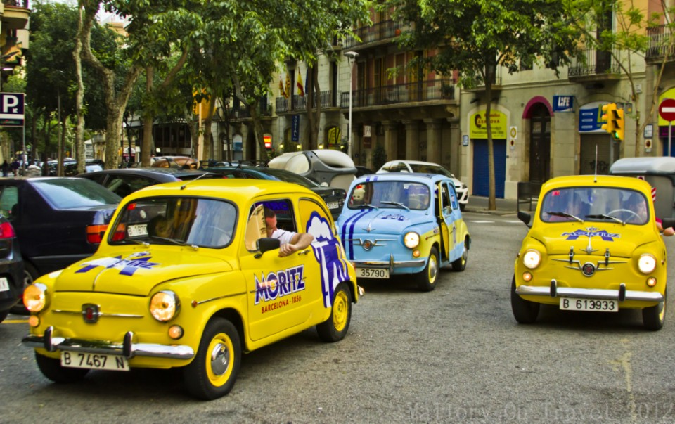 Taking the Barcelona tour in SEAT 600s on Mallory on Travel adventure photography