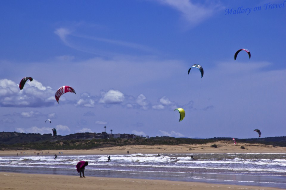 Kitesurfers on the windy city beach of Essaouira, Morocco on Mallory on Travel adventure photography