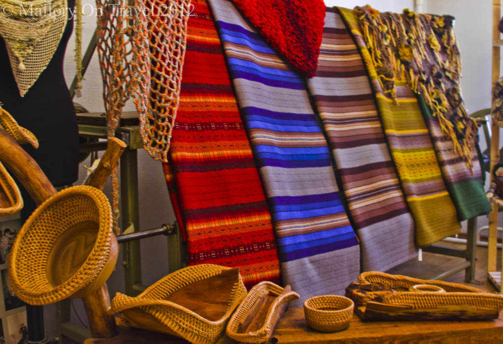 Handmade textiles in baskets and scarves on sale at the artisans shop in Latvian Liepaja on Mallory on Travel adventure photography
