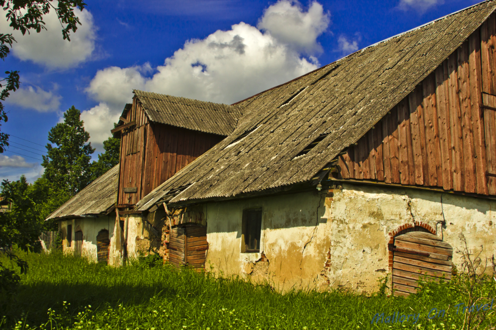 Beautiful rural farmhouses on the Riga to Liepaja road in Baltic Latvia on Mallory on Travel adventure photography