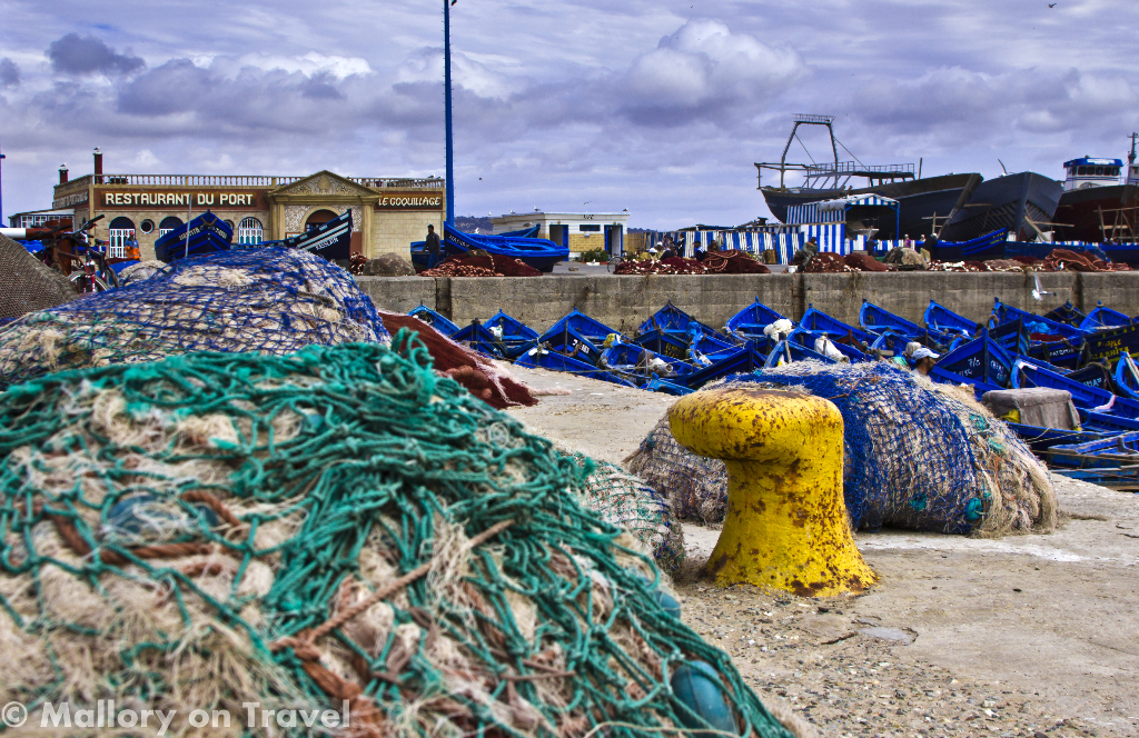 The fleet of blue longlining craft and nets of Essaouira, Morocco on Mallory on Travel adventure photography