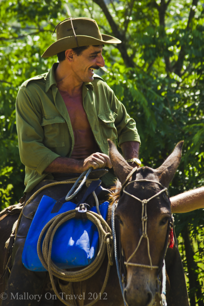 Character on horseback on the Cienfuegos road in Cuba on Mallory on Travel adventure photography