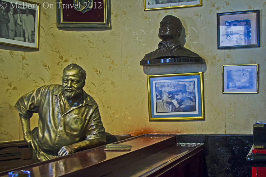 Ernest Hemmingway statue in La Floridita bar in Old Havana, Cuba on Mallory on Travel adventure photography
