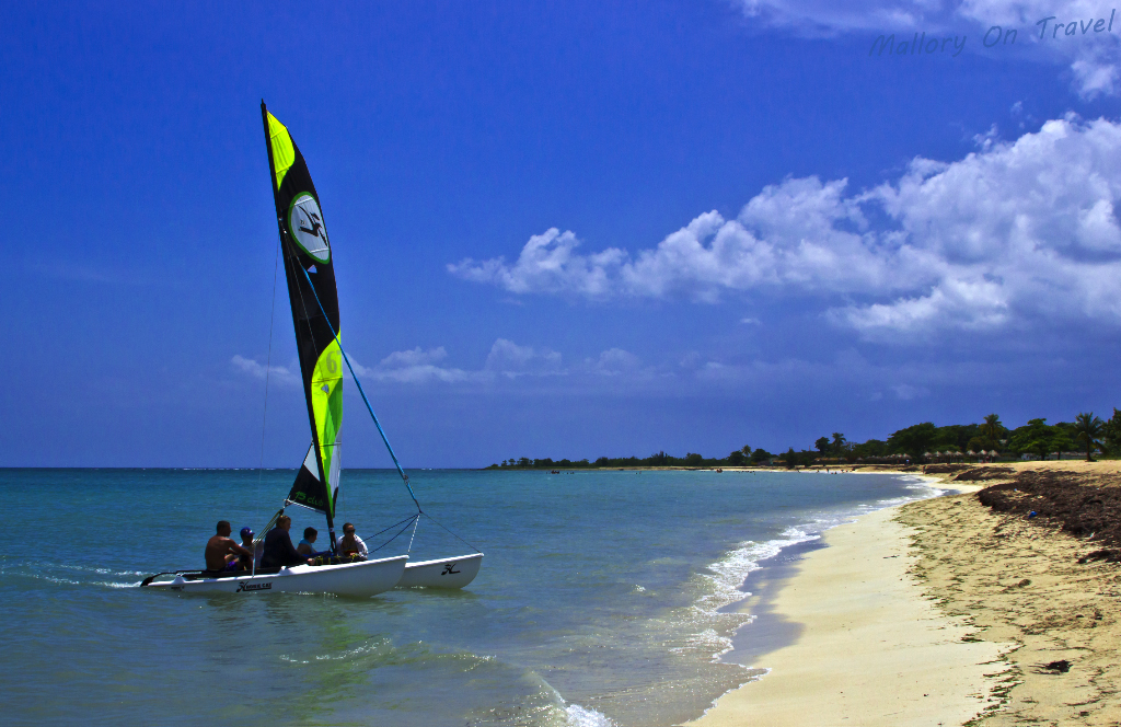 Sailing a catmarran in the Caribbean on Ancon Beach near Trinidad, Cuba on Mallory on Travel adventure photography