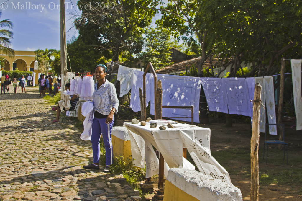 Selling white linen outside the Manacas Iznaga plantation near Trinidad, Cuba on Mallory on Travel adventure photography