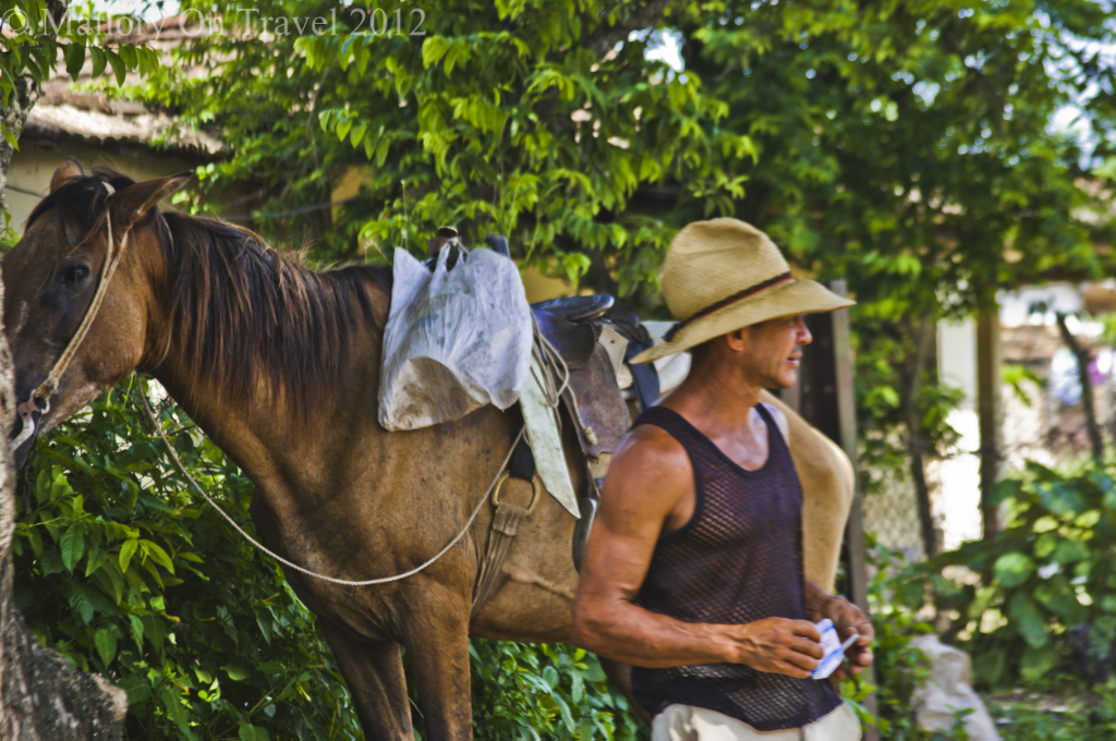 Local horseman near Trinidad on Cuba on Mallory on Travel adventure photography