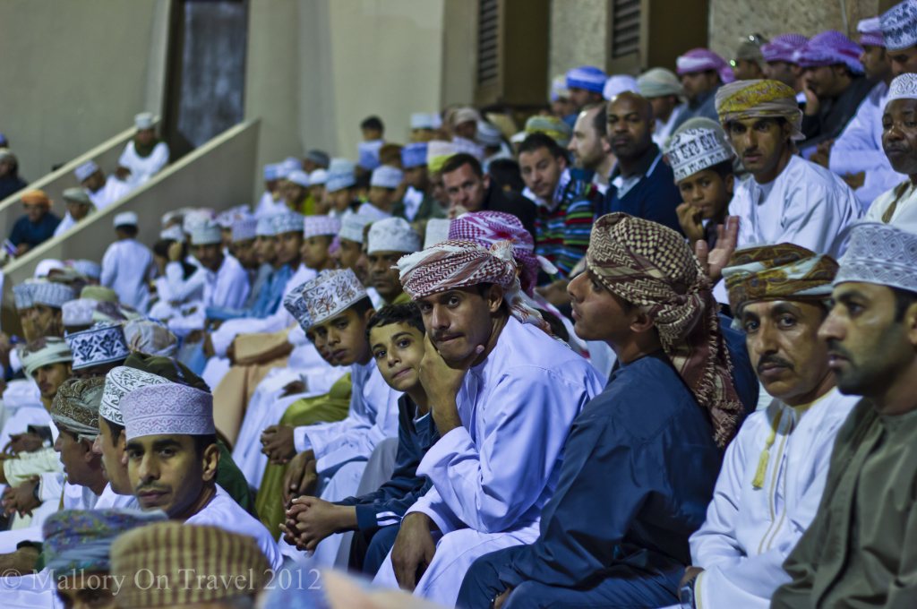Male spectators at the Muscat Festival in Oman on Mallory on Travel adventure photography