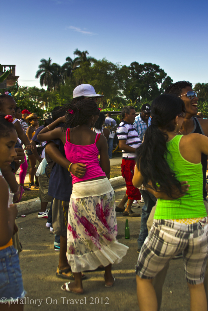 Children and young people dance at the Camaguey Carnival on the Caribbean island of Cuba on Mallory on Travel adventure photography