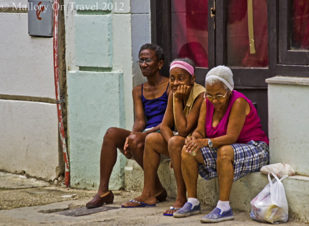 Three wise but bored ladies in Havana, Cuba in the Caribbean on Mallory on Travel adventure photography