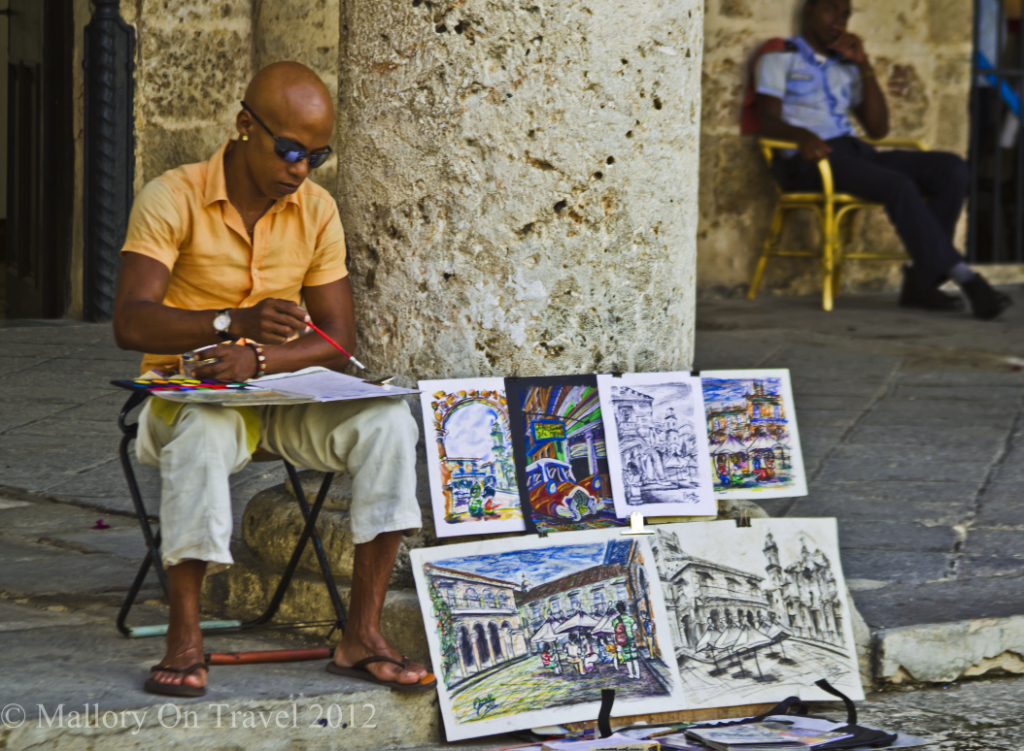 Artist at work in Havana, Cuba in the Caribbean on Mallory on Travel adventure photography