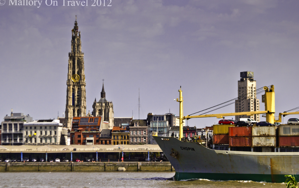 A large parcel tanker prepares to pass in front of Antwerp Cathedral of Our Lady, Flanders region of Belgium on Mallory on Travel adventure photography