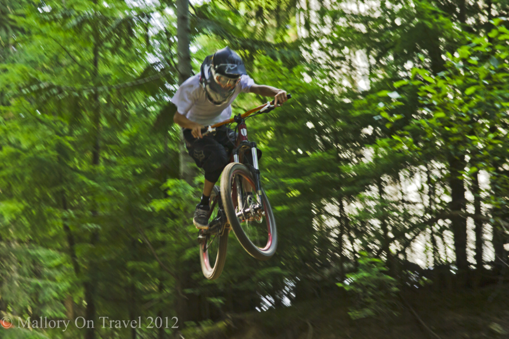 Mountain biker high on  'airtime' at Whistler Bike Park, British Columbia, Canada on Mallory on Travel adventure photography