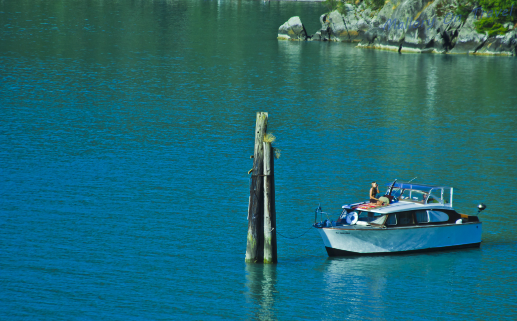 Quiet coves ideal for fishing line the Rocky Mountaineer route from Vancouver to Whistler in British Columbia, Canada on Mallory on Travel adventure photography