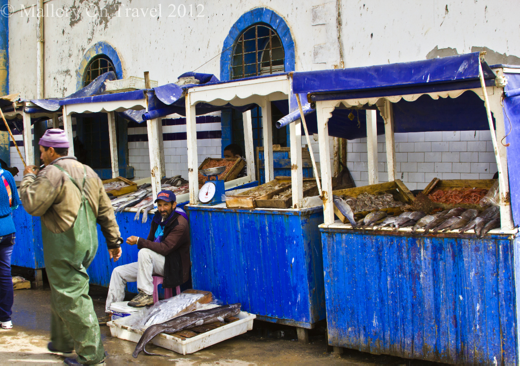 The unclean stalls and merchants of the fish market in Essaouira on the Atlantic coast of Morocco in North Africa