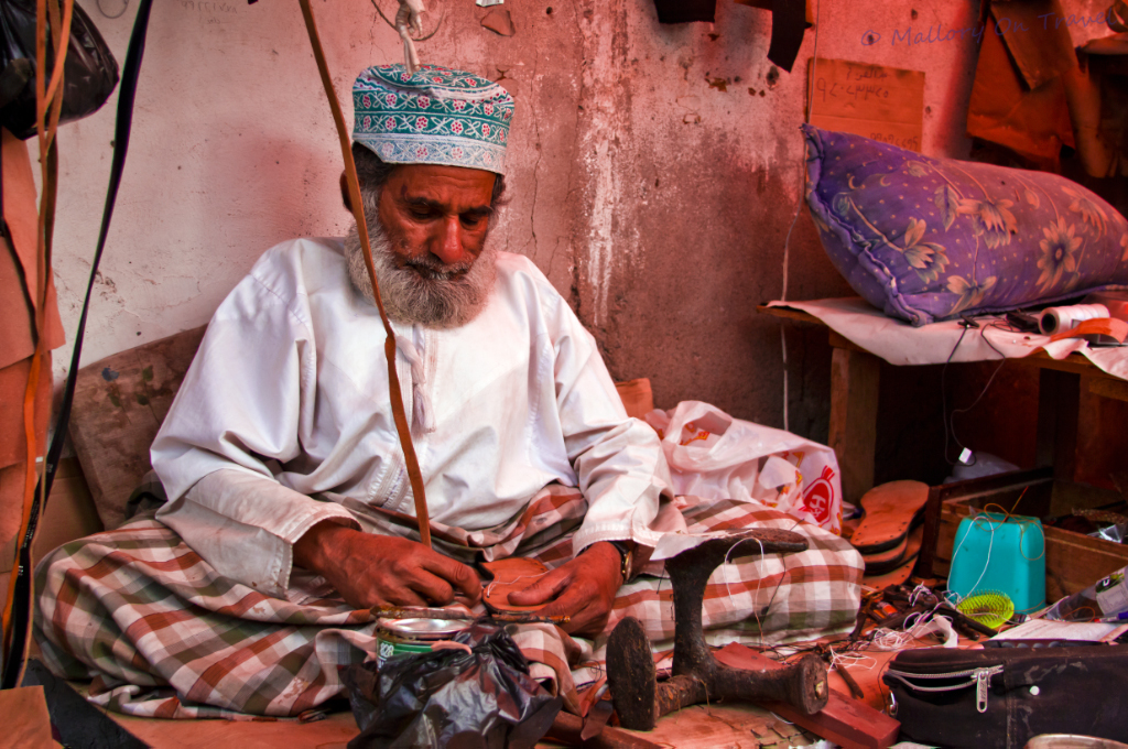 Shoe repairs in the souq at Seeb near Muscat in Oman on Mallory on Travel, adventure, adventure travel, photography Iain-Mallory-153_edited-1.jpg omani_shoemaker