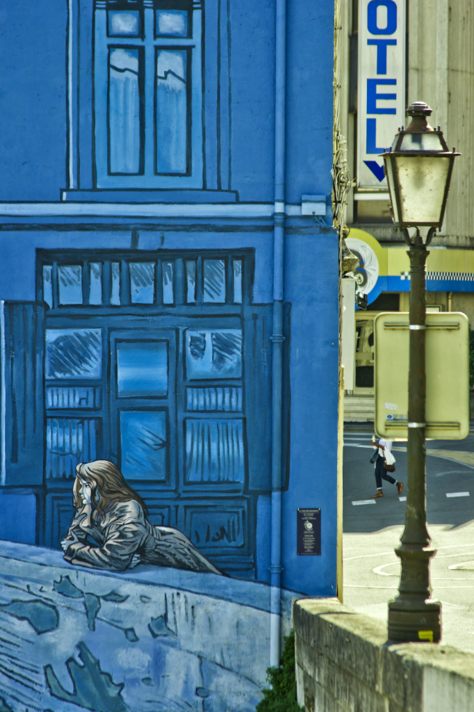 The 'watcher from the ramparts' on the Trompe L'oeil part of the Painted Walls comic mural project in Angoulême in the Poitou-Charentes region of France on Mallory on Travel adventure photography