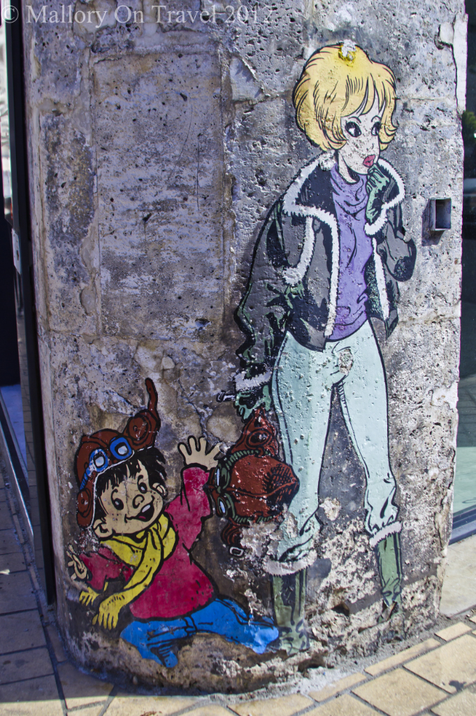 A weather worn comic mural project in comic city Angoulême in the Poitou-Charentes region of France on Mallory on Travel adventure photography