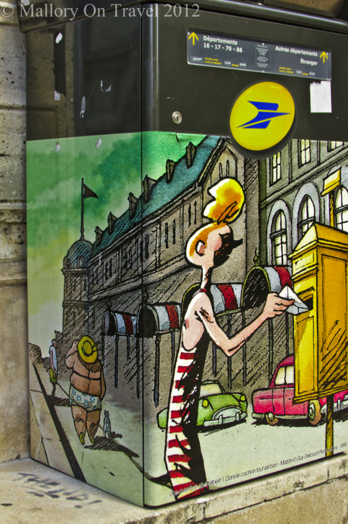 A colourful comic mural postbox in comic city, Angoulême in the Poitou-Charentes region of France on Mallory on Travel adventure photography