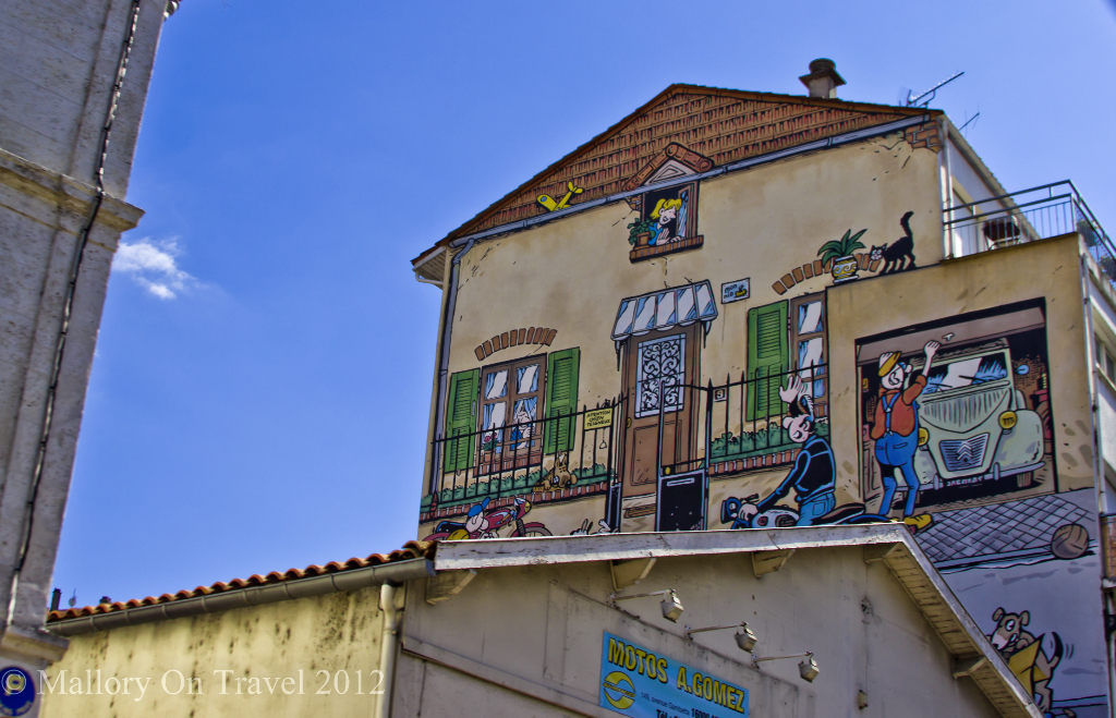A comic mural high on a home part of the Painted Walls project Angoulême in the Poitou-Charentes region of France on Mallory on Travel adventure photography