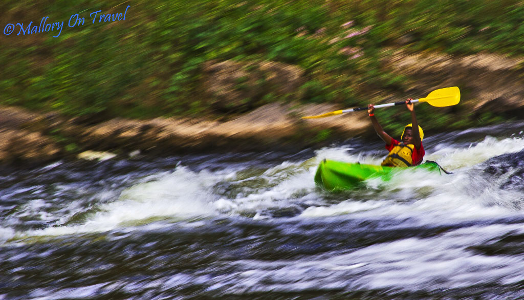Young white water kayaker on the River Aveyron near Najac in the French Midi-Pyrenees on Mallory on Travel adventure photography