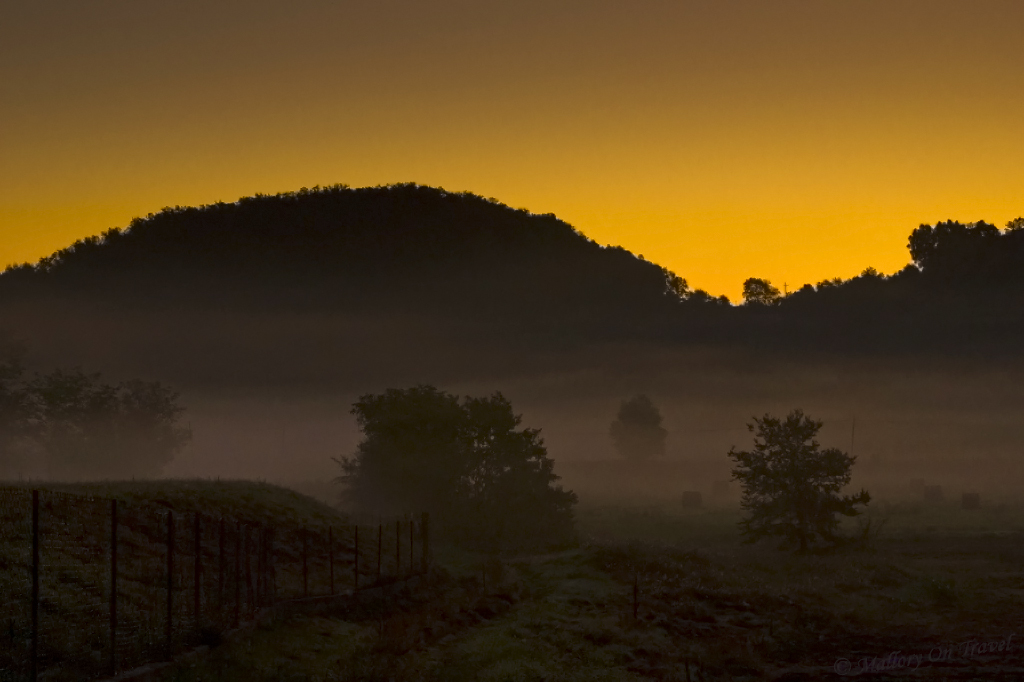 A misty autumn sunrise in the volcanic La Garrotxa in Catalonian Spain on Mallory on Travel adventure photography