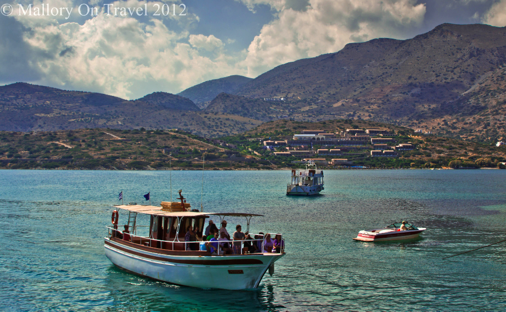 Cruise vessels and pleasure craft off the island of Spinalonga near Elouda on Crete in Greece on Mallory on Travel adventure photography
