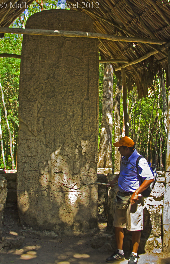 Explaining hieroglyphic text at the archeological site of Cobá, near Riviera Maya, Mexico on Mallory on Travel adventure photography